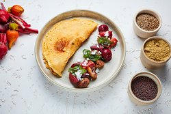 Beetroot and Chestnut Chilla Pancake (v) with a dill and mustard yoghurt dressing