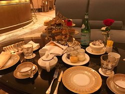 High Tea for two was US $100 (total) and included sandwiches, scones with crème and jams, pastries, Pellegrino, tea (menu to choose from) and Cappuccino with 24 Karat Gold sprinkles.