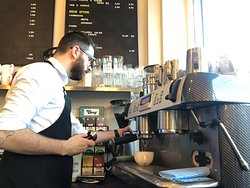Staff member making a delicious coffee.