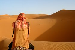 THE MOMENT OF MEDITATION ON THE SEA SAND DUNES OF ERG CHEBBI