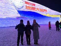 Harbin Private Tour Guide English-speaking Emmy Xu  with her guests at Harbin ice and snow world for ice festival 27  December 2019, all our tour guide must accompany the guests into park and explain something to their guests