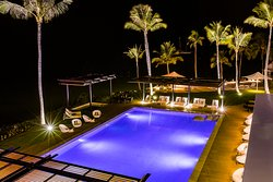 Relax in the restaurant and pool area, beautifully lit at night.