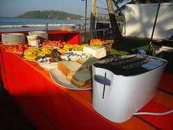 Out door breakfast table at beach and customer can enjoy their breakfast under morning sunshine.