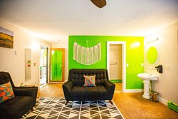 Our green room is ready for your family trip! Equipped with two queen memory foam beds, and one twin memory foam bed. Includes it's own bathtub and shower, with places to sit and spend time with your loved ones.