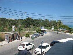 Afrodite Hotel. Вид из окна моего номера. Автобусная остановка рядом с отелем. Корфу. Поселок Рода. 08 - 18 августа 2019 года.