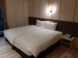 Clean room with firm and comfortable bed