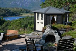 Cottage's outdoor area with annex and fireplaces.