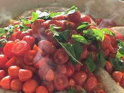 Stewing tomatoes with freshly picked basil.