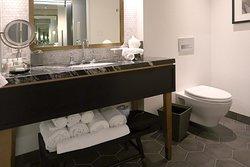 LondonHouse Chicago, Curio Collection by Hilton, 85 E Wacker Drive, Chicago - Room 1909 - Bathroom w/ Single Sink - Towel Storage Below
