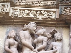 Ancient rock carvings in temples of khurajao, India - depicting erotica to promote family formation.