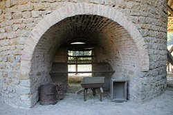 Close-up view of one of the kilns and the tools used to empty them