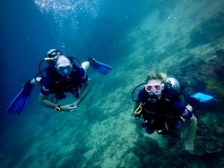 Father and daughter blowing bubbles @alegria Dive Resort