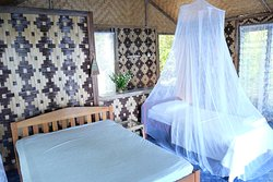 Room in bungalow 1. Mosquito net can be added to double bed depending on number of guests staying.