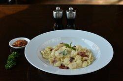 Orecchiette pasta, ham and scallops, creamy garlic sauce