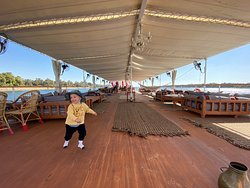 This is the top deck of the boat and has so much space for the 18 passengers that this ship holds.  This is our 2 year old son having a little dance party as we sail along the river!