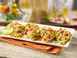 Crisp tostadas topped with fresh quacamole, blackened shrimp, crisp lettuce, Feta cheese, jalapeño, Aioli Sriracha sauces and pico de gallo. Garnished with chopped cilantro and a lime wedge