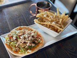 Grilled Chicken Pita- red pepper hummus, lettuce, tomato, feta, tahini sauce with Crete fries