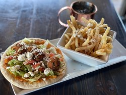 Falafel- red pepper hummus, lettuce, tomato, feta, tahini sauce with Crete fries