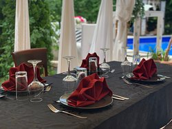 Table on the terrace overlooking the pool.