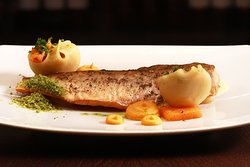 Arctic char fillet - the Oginski recipe from the 18th century. Baked root vegetables, red lentil pasta, herbs, lemon-flavoured almond sauce