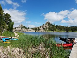 Near the gift shop area, you can rent canoes and take them out on the lake. This is around where the trail starts heading West.