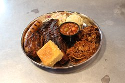 Can't decide?! check out this massive barbeque plate, filled with all the staples smoked onsite every day!