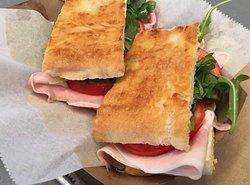focaccia sandwich with melted mozzarella and Italian ham
