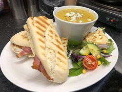 Bacon Brie and onion chutney panini with a cup of parsnip and apple soup- topped with goats cheese and walnut.