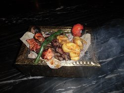 Chicken skewers, lamb Skewers, Beef Skewers, with grilled vegetable and french fries