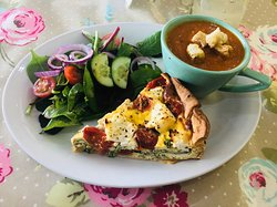 Home made goats cheese spinach and tomato quiche with tomato and lentil soup
