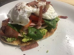 Smashed avocado, ham & poached eggs on a toasted flatbread
