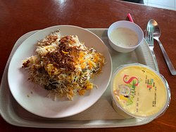 Briani food - Basmati coloured (saffron) rice, spices and meat or chicken.