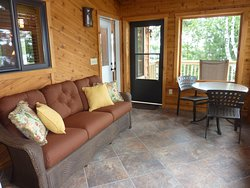 Spacious and comfortable screen porch on one bedroom, lakefront Point Vacation Home Cabin