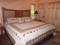 King bed in the one bedroom Point Vacation Home Cabin.