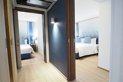 Two Bedroom Family Suite -614-sq-foot (57-sq-meter)  -A connecting room with Living room, Master Bedroom and Small Bedroom, Balcony, Kitchen, 2 Private Toilets
