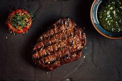 Steaks are served w/ house Salsa Verde. -- Steaky podáváme s domácí Salsou Verde.