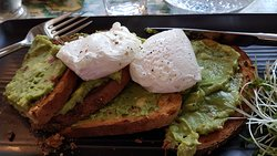 Crushed Avocado with chillies, lime and coriander on toasted bloomer with two poached eggs