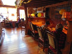 Sit for a relaxing meal with friends in our barn wood decor.