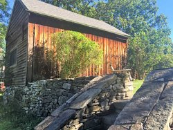 This 200 year old corn crib is currently being renovated into a bar/lounge off of our 1,600 sq. ft. Vermont slate patio and newly built 14 ft. high fireplace. The perfect spot to relax or host a wedding or event.