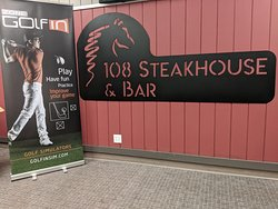 We offer a golf simulator in our 108 Steakhouse & Bar!