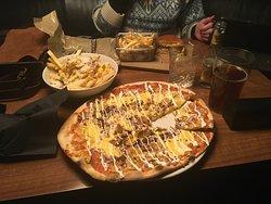 Cheesy fries with jalapeños, nacho pizza, cheese burger and fries, Harahorn Pink gin and local drought lager