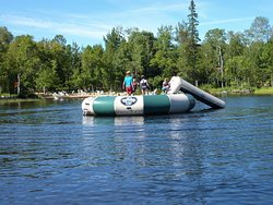 Floating island raft with a slide at the north sand beach.