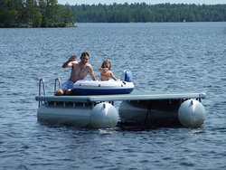Nothing beats an afternoon at the beach that has a floating island to play on!
