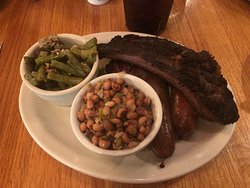 2 meat combo (2nd cut brisket and sausage) with a side of a beef rib, green beans and jalapeno black-eyed peas