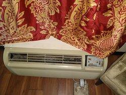 Flooring missing, radiator control panel missing