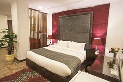 Our junior executive room with a king size bed, en-suite bathroom, a mini fridge, TV and 1 sofa bed.