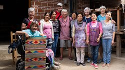Our group with the family of weavers.