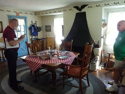 Tourist and tour guide in Stafford-Whitman farm-house kitchen