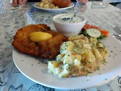 Schnitzel, warm potato salad and dill cucumbers.