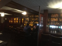 The bar has a great selection of whiskey on all of it's walls.